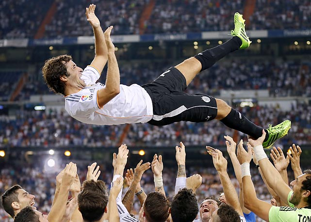 Real Madrid's Raul Gonzalez Blanco is thrown in the air after the Santiago Bernabeu trophy soccer match between Real Madrid and Al Sadd.