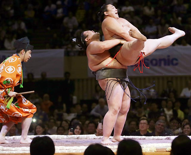 "Sumo wrestlers perform during an exhibition titled ""Sumo Tournament In Jakarta,"" at Istora stadium in Jakarta, Indonesia. The exhibition was held to mark the 40th anniversary of Japanese-ASEAN cooperation and the 55th anniversary of diplomatic relations between Indonesia and Japan."