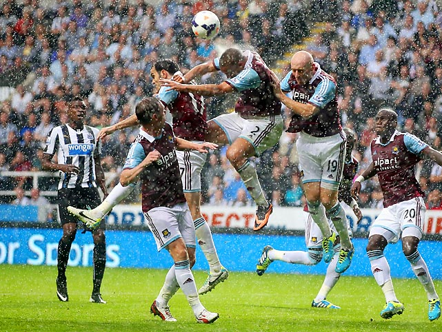 Winston Reid of West Ham heads the ball clear during the Barclays Premier League match against Newcastle United.