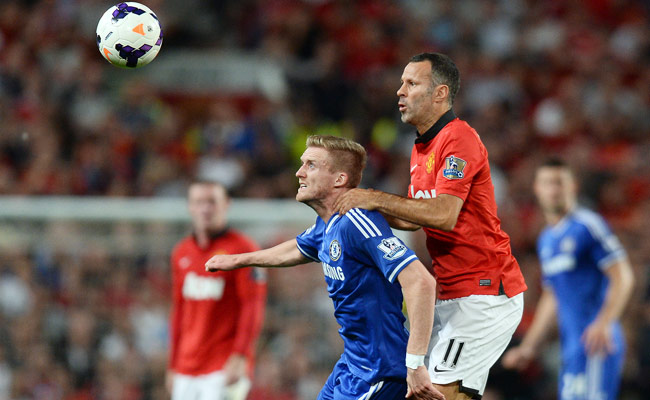 Deployed as a center-forward, Andre Schurrle (left) struggled against Manchester United's defense.
