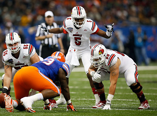 Louisville quarterback Teddy Bridgewater (5) went 20-of-32 for 266 yards and two TDs against Florida.