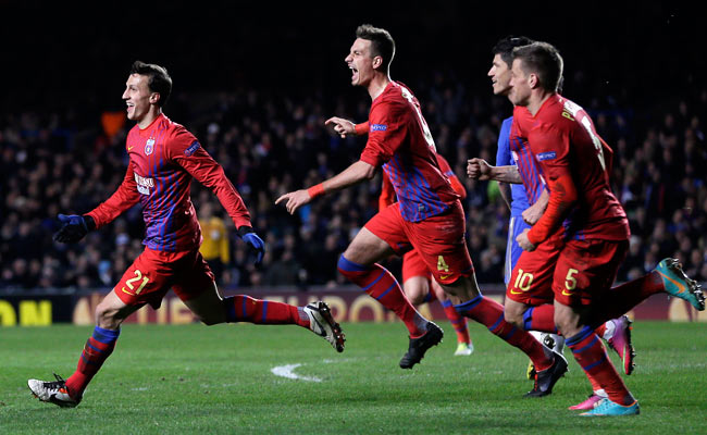 Vlad Chiriches (left) celebrates after scoring a goal against Chelsea in the Europa League.