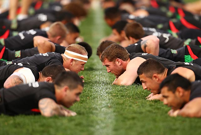 Searching for their coach's contact lens is all part of a grueling day's training for the South Sydney Rabbitohs at Redfern Oval in Sydney, Australia.