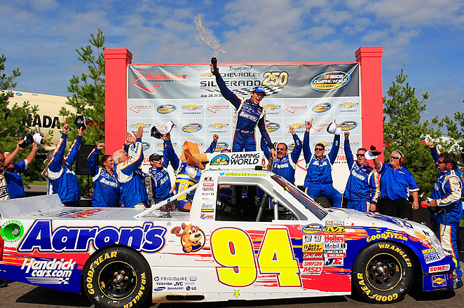 Chase Elliott plowed into Ty Dillon on the final turn of the course to take the lead and claim his first series victory.