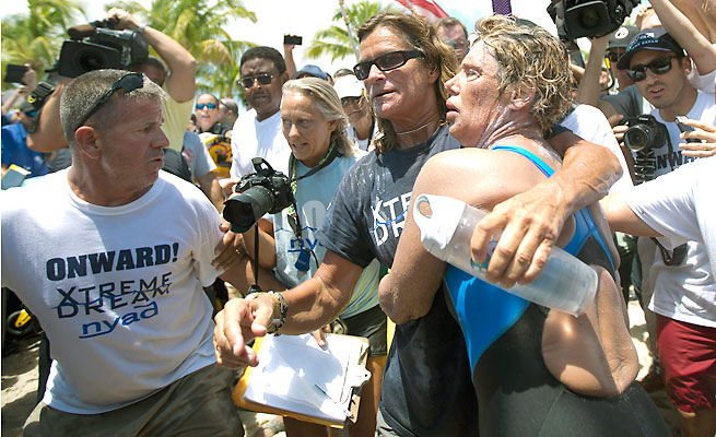 Diana Nyad, right, became the first person to swim from Cuba to Florida without a shark cage.