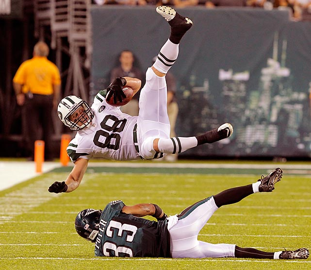 Eagles cornerback Jordan Poyer upends Jets tight end Konrad Reuland during New York's 27-20 preseason victory on Aug. 29. Reuland caught six passes for 30 yards against Philadelphia, but also lost one fumble.