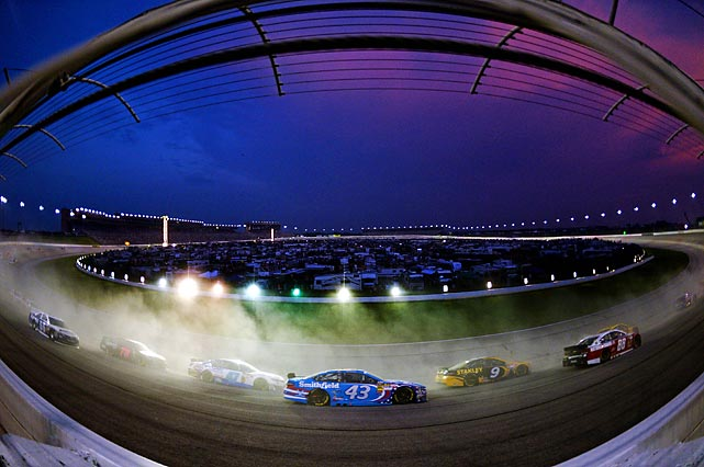 A pack of cars race in the NASCAR Sprint Cup Series AdvoCare 500 at Atlanta Motor Speedway on Sunday. Kyle Busch won the race, his fourth victory of the year, clinching a spot in the Chase for the championship.