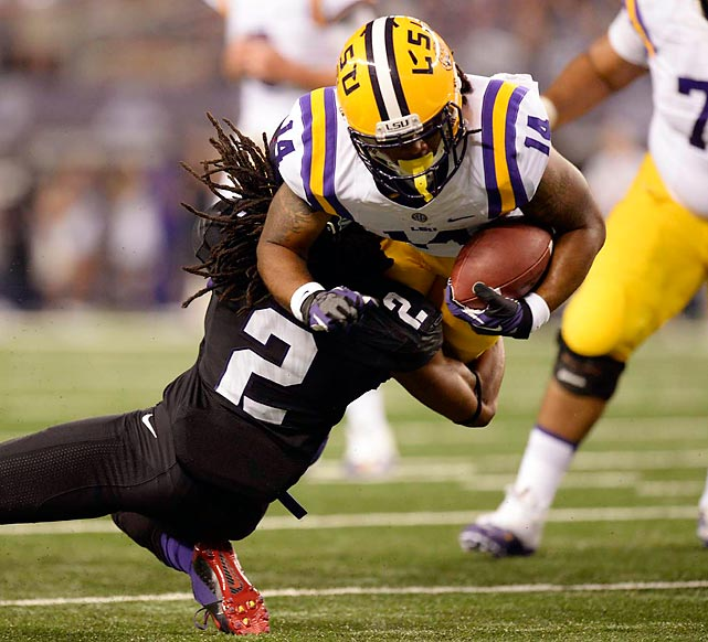 TCU cornerback Jason Verrett (2) brings down LSU running back Terrence Magee during the No. 12 Tigers' 37-27 victory over the 20th-ranked Horned Frogs last Saturday. McGee rushed for 95 yards on 13 carries and scored two touchdowns as part of a potent LSU ground game that gained 197 yards.
