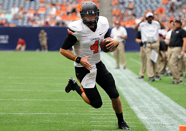 After replacing Clint Chelf, Oklahoma State quarterback J.W. Walsh racked up 260 total yards and a TD.