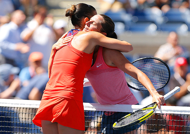 Flavia Pennetta (left) defeated fellow Italian Roberta Vinci, seeded No. 10, to advance to the semifinals.