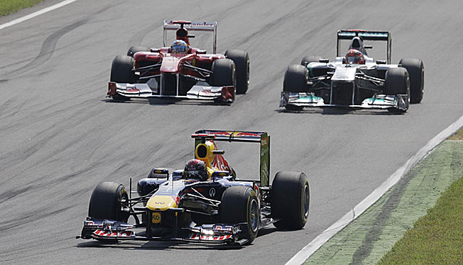 Sebastian Vettel (front) has extended his points lead heading to the race at Monza.