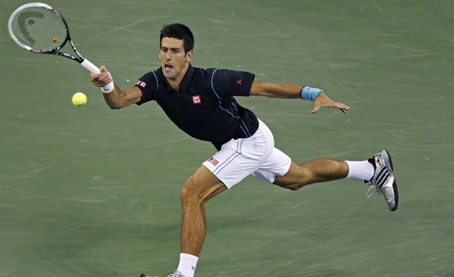 Novak Djokovic beat Mikhail Youzhny to reach his seventh straight U.S. Open semifinal.