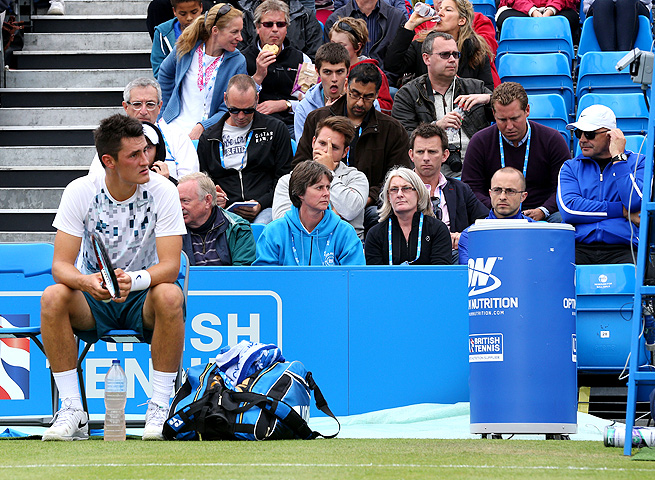 John Tomic (in white hat) watches his son Bernard Tomic play in the AEGON Championships in London.