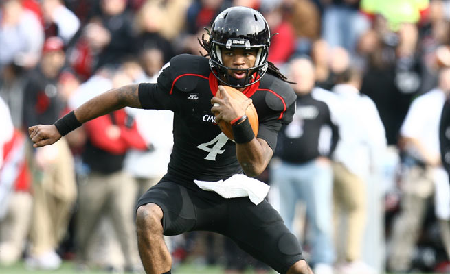 Cincinnati QB Munchie Legeaux threw for 237 yards and a touchdown before leaving with an injury.