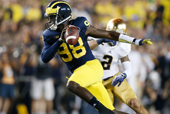 Devin Gardner threw four touchdowns and ran for another in Michigan's 41-30 win Saturday night.