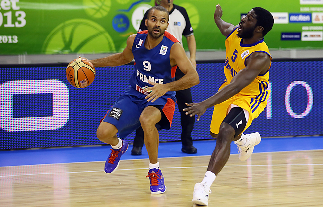 Tony Parker's 28 points led France past Ukraine and into the second round at the Euro championships.