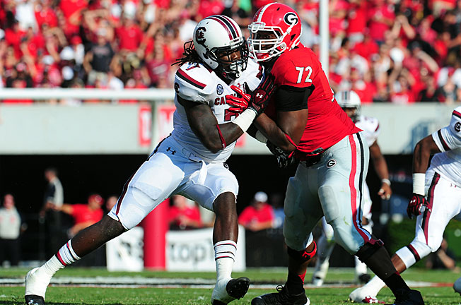 Georgia held Jadeveon Clowney largely in check while knocking off South Carolina in an SEC East clash.