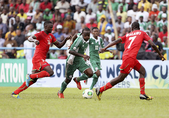 Victor Moses (center) was on the mark in Nigeria's victory over Malawi.