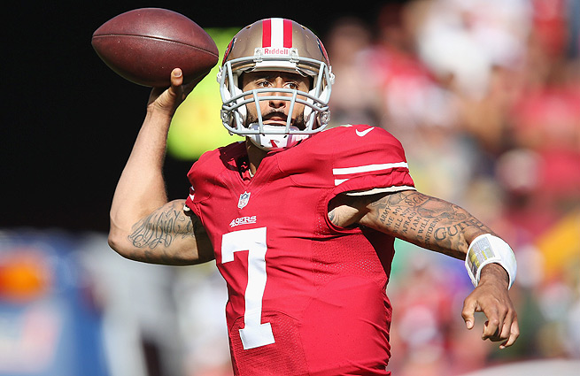 Colin Kaepernick passed for a career-high 412 yards in the Niners' 34-28 win over the Packers.
