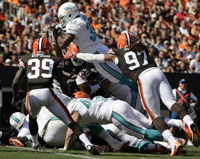 Daniel Thomas had eight carries for 14 yards and this scoring plunge for the Dolphins.