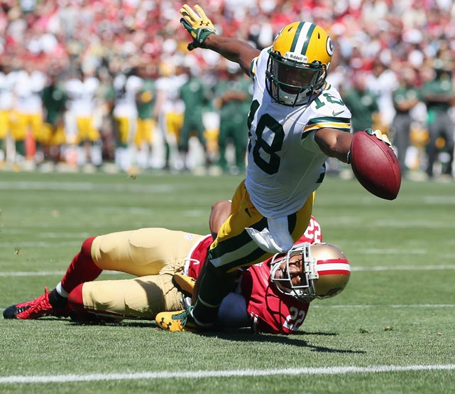Randall Cobb was successful in stretching far enough to score on this play while being pulled down by Carlos Rogers.