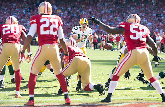 Aaron Rodgers (center) and the Packers fell to the 49ers 34-28 Sunday afternoon.