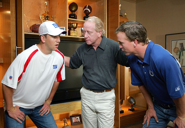 Eli, Archie and Peyton huddle while filming a commercial for Reebok.