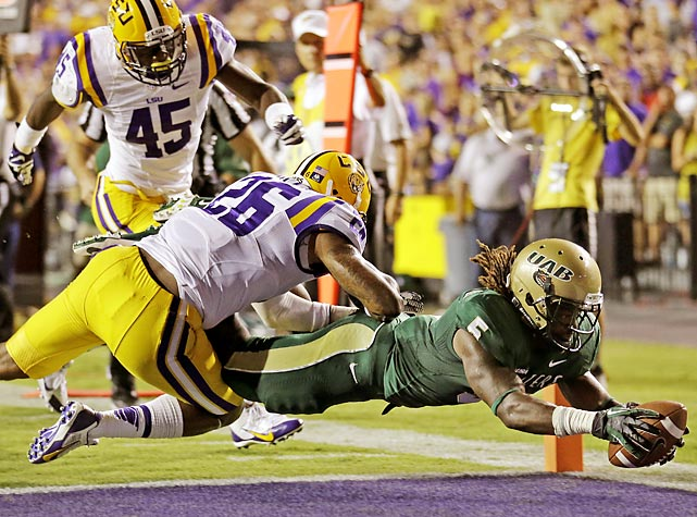 UAB running back Darrin Reaves (5) dives for a touchdown past LSU safety Ronald Martin (26) and ahead of linebacker Deion Jones (45) during the second quarter of the ninth-ranked Tigers' 56-17 victory over the Blazers in Baton Rouge, La., on Sept. 7. With the win, LSU moved up to No. 8 in the AP Top 25.