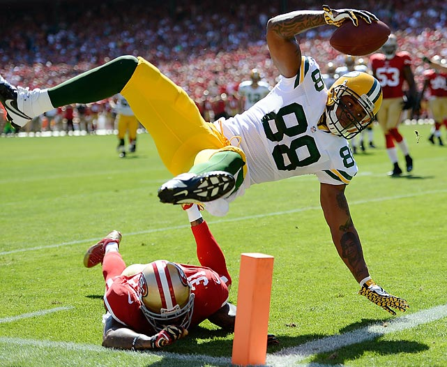 Packers tight end Jermichael Finley (88) tumbles over 49ers safety Donte Whitner to score on a 12-yard pass from quarterback Aaron Rodgers during the second quarter of San Francisco's 34-28 defeat of Green Bay on Sept. 8. Finley had five catches for 56 yards in the game, but he also dropped a pass that was then intercepted by 49ers safety Eric Reid.