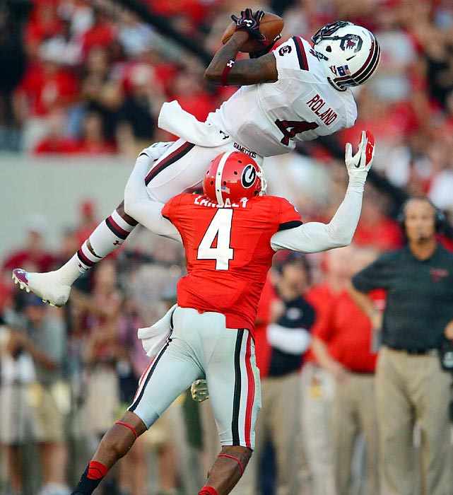Sophomore wideout Shaq Roland of No. 6 South Carolina bends over backward to catch a pass against Georgia cornerback Brendan Langley during the 11th-ranked Bulldogs' 41-30 victory over the Gamecocks on Sept. 7. With the win, Georgia jumped up to No. 9 in the AP Top 25, while South Carolina fell to No. 13.