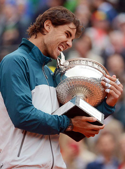 Second-seeded Rafael Nadal takes a bite out of the U.S. Open trophy after defeating No. 1 seed Novak Djokovic 6-2, 3-6, 6-4, 6-1, in the Men's Singles final on Sept. 9. In his career, Nadal, 27, has now won two Open titles and 13 Grand Slam championships.