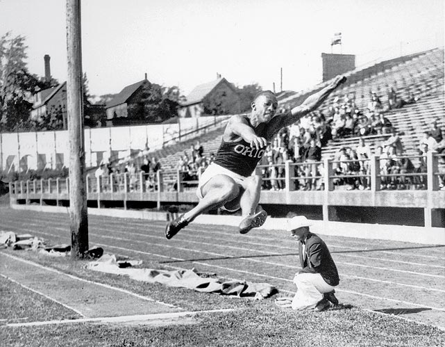 Owens is shown at the Central Intercollegiate Conference meet on June 7, 1935 as he broke the accepted world broad jump record with a leap of 26 feet 2½ inches.