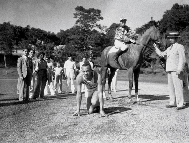 Owens poses at the starting line before he raced a horse at Tropical Park in Havana, Cuba, on Dec. 26, 1936. Owens ran 100 yards in 9.9 seconds. He finished 20 yards ahead of the horse, which was handicapped 40 yards at the start.