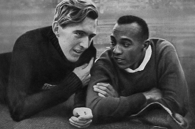 Owens and German champion Luz Long chat together in the Berlin stadium on Aug. 1, 1936 during the Olympic Games.