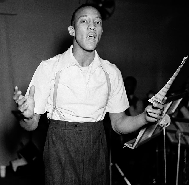 Owens rehearses with his band in New York on Feb. 10, 1937, as he planned to start on a tour of the country as a song and dance man.
