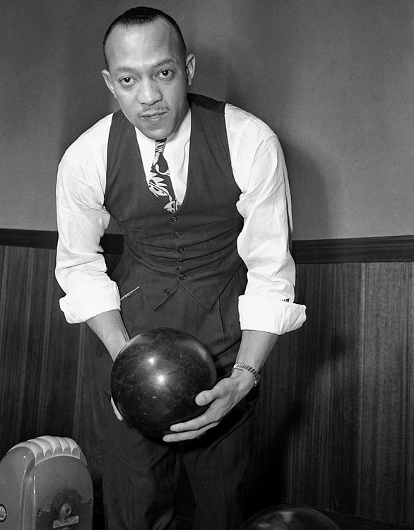 Owens poses while bowling near his home in Detroit on March 7, 1944.