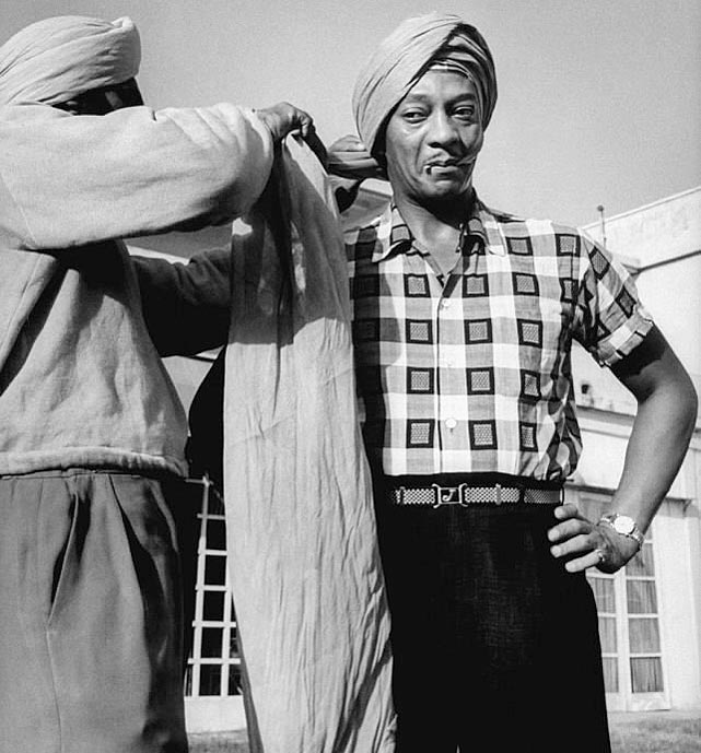 Owens has a turban wrapped to his head while in India in October 1955.