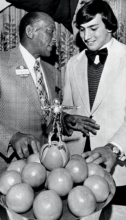 Owens and Penn State running back John Cappelletti eye oranges stacked in the 1974 Orange Bowl Trophy during the awards presentation to Nittany Lion players, at which Owens was guest speaker at University Park, Penn., on Jan. 22, 1974.