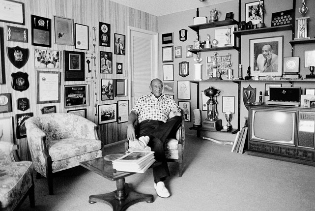 Owens sits, surrounded by mementos of his athletics career at his home in Phoenix, Ariz., in 1975.