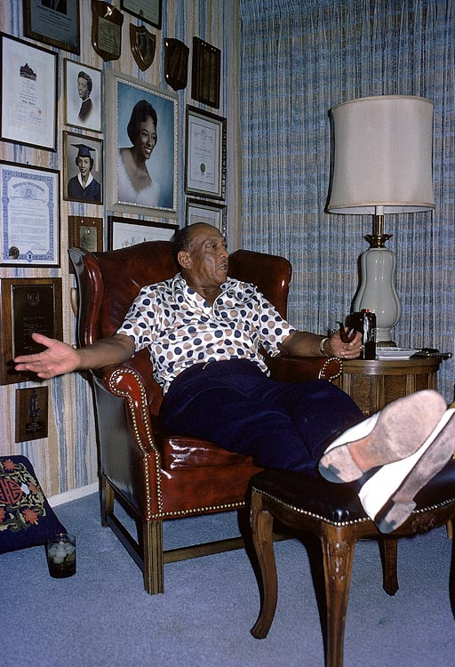 Owens relaxes at home with his pipe in 1975.