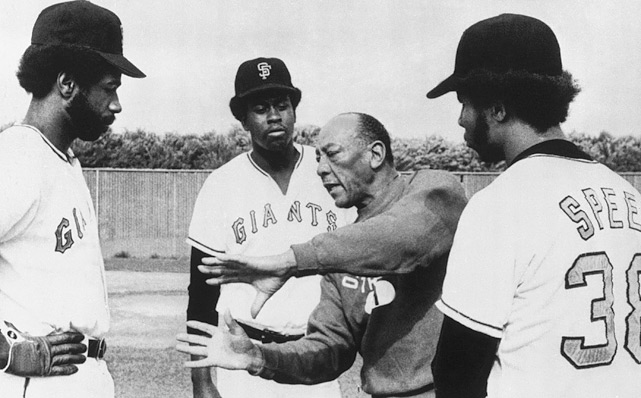 Owens talks with three of the fastest San Francisco Giants (left to right) Garry Maddox, Gary Matthews and Horace Speed, during spring training drills in Casa Grande, Ariz., on March 8, 1975.