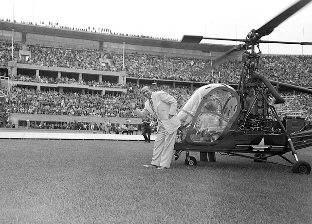Jesse Owens was flown into the Berlin stadium by helicopter and a whirlwind of applause accompanied him, Aug. 22, 1951.