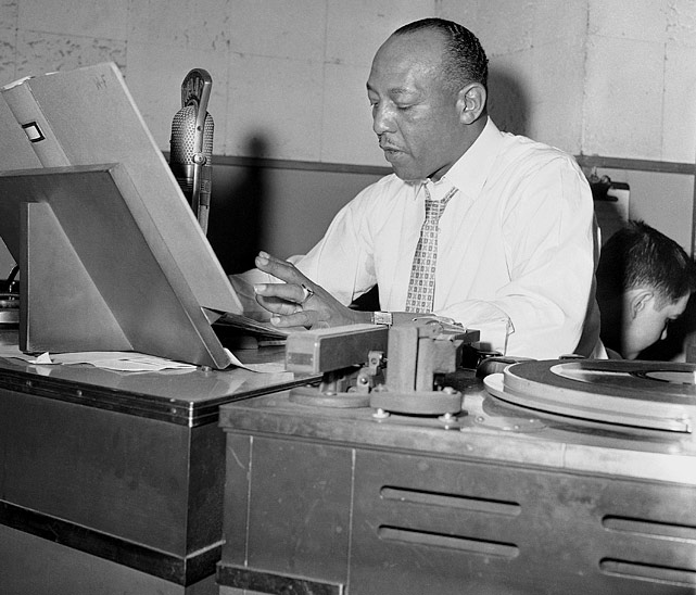 A disc jockey and sports specialist for the Illinois Youth Commission, Owens is pictured here in Chicago on May 18, 1960.