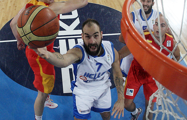 Vassilis Spanoulis led Greece to an upset win over defending Euro champs Spain with 20 points.