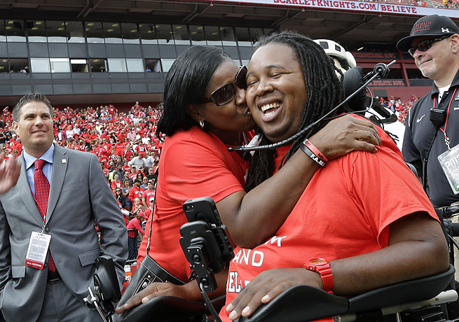 Eric LeGrand received a kiss from his mother during his jersey retirement ceremony in Piscataway, N.J.