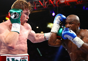 Saul Alvarez (left) takes a shot at Floyd Mayweather in Saturday night's fight.