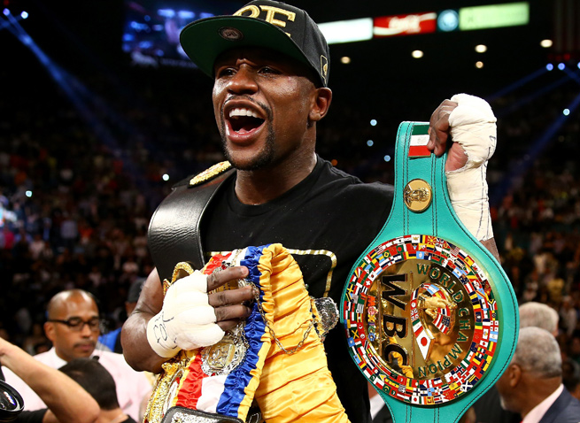 Floyd Mayweather improved his record to 45-0 by beating Saul 'Canelo' Alvarez in 12 rounds.