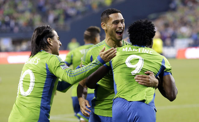 Lamar Neagle (center) has scored in three straight games for Seattle.