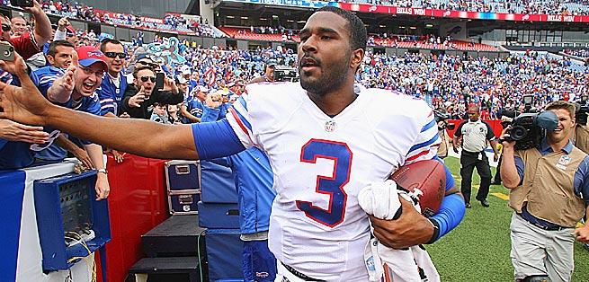 EJ Manuel celebrated his first NFL win with appreciative Bills fans and this proud dad (below, right).
