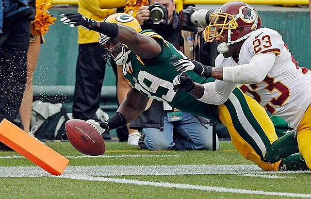 Had he not been knocked out of bounds, James Jones might have scored on this play.